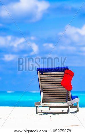 Red santa sock on beach chair at tropical vacation