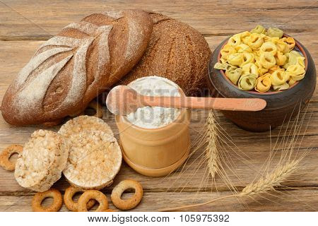 Products made of wheat on wooden table.