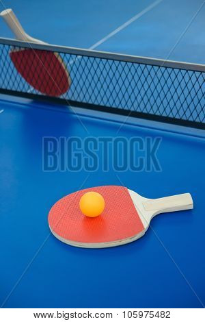 Pingpong Rackets And Ball On A Blue Pingpong Table