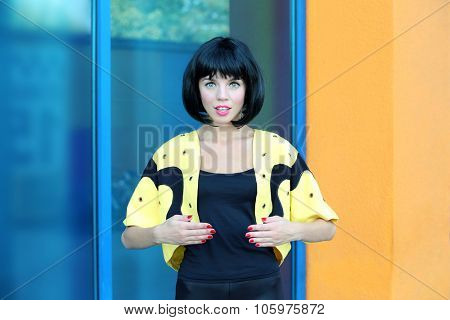 Young woman outside the building