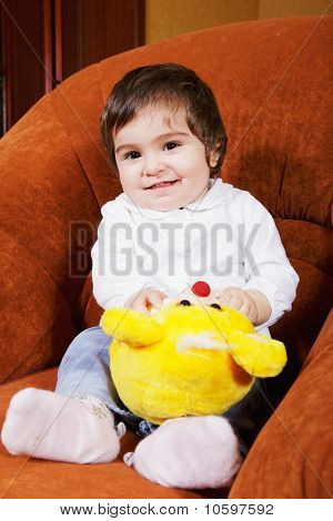 Smiling Baby Girl With Toy