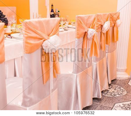 row of decorated chairs at restaurant