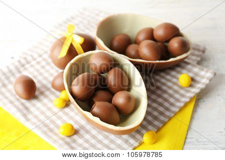 Chocolate Easter eggs on white wooden background