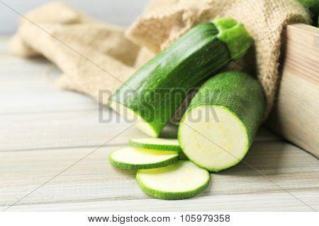 Fresh zucchini on wooden background