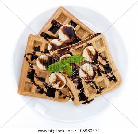 Waffles With Bananas And Chocolate Sauce (over White)