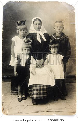 Ancient photo of grandmother with children