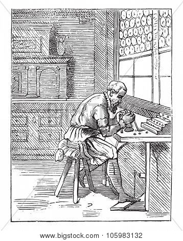 A lapidary in the sixteenth century, vintage engraved illustration. Magasin Pittoresque 1882.