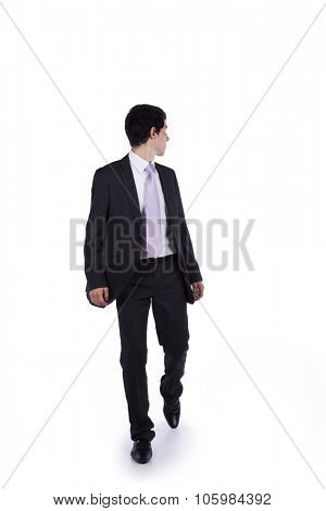 Businessman walking and looking back isolated on white (some motion blur)