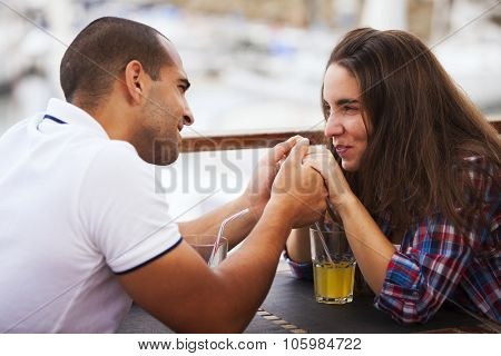 Couple enjoying their love at the bar