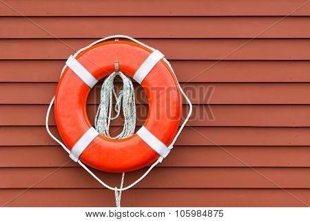 Ring Buoy On Red Wooden Wall, Copy Space
