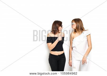 High-fashion. Glamorous stylish young women model with red lips in a black white bright hipster clot