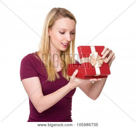 Caucasian woman unwrap of gift box