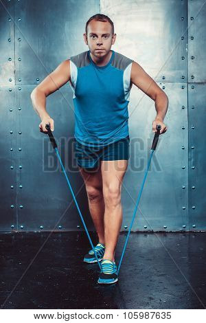 Sportsmen. Fit Male Trainer Man Doing Exercises With Expanders, Concept Fitness Workout Strenght Pow