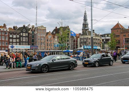 Cars And People On The Waterfront In Amsterdam