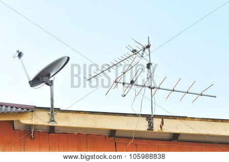 Satellite Dish And Tv Antenna At The Roof