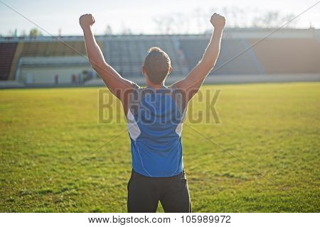 Athletic Man Is Happy And Rejoicing At The Stadium, Raised His Hands Up. Winner
