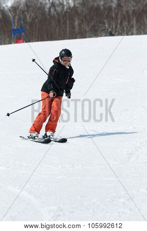 Girl Skier Coming Down The Ski From A Mountain On A Sunny Day