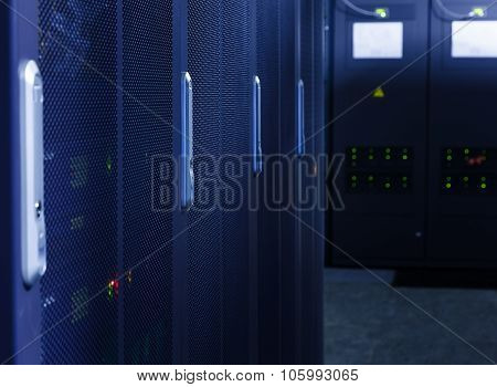 rows of mainframe hardware with blur in server room