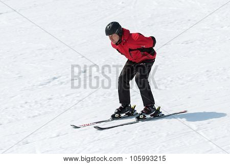 Skier Coming Down The Slope Without Ski Sticks