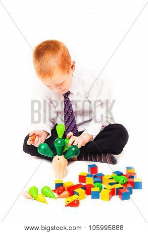 Boy playing with wooden toys