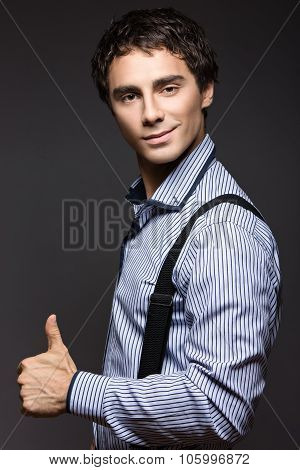 Serious Young Man In  Striped Shirt With Suspenders.  Business Style.