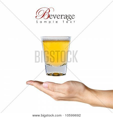 A Glass Of Beer Over The Human Hand With Copy Space