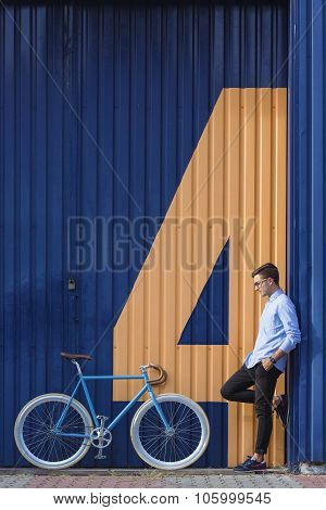 Businessman Standing Beside His Bike