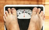 foto of morbid  - Feet of a fat person on a weight scale  - JPG