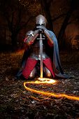 stock photo of armor suit  - Medieval knight in the armor with the sword - JPG