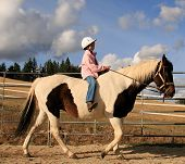 image of bareback  - happy girl riding bareback on a paint horse - JPG
