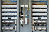 stock photo of busbar  - new control panel with static energy meters and circuit-breakers (fuse)
