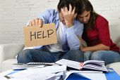 Young Couple Worried At Home In Bad Financial Situation Stress Asking For Help poster