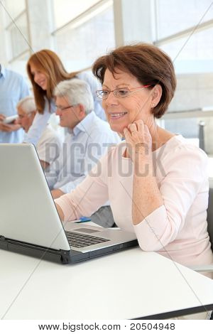 Senior woman attending business training