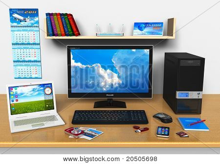 Office workplace with desktop computer, laptop and other devices