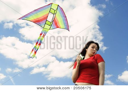 Young Girl In Red Shirt Flying Kite, Blue Sky