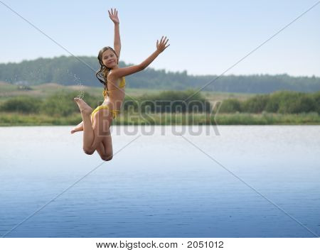 Girl Jumping Above Water Smooth Surface