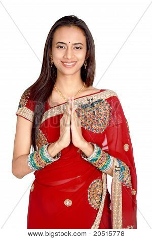 Young Indian In A Namaste(greeting) Pose.