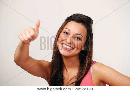 Thumbs up - smiling ethnic female