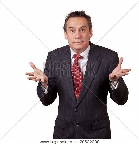 Attractive Wide Eyed Middle Age Business Man in Suit Shrugging