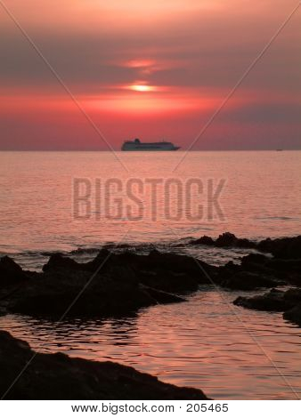 Sunrise With A Cruise Ship On Shore