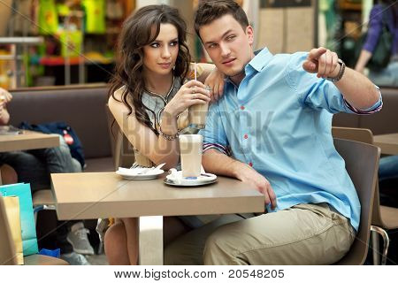 Elegant couple having fun at lunch in shopping mall