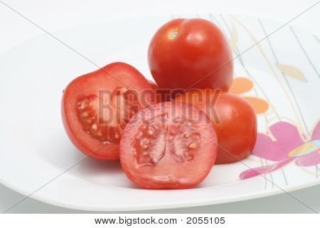 Sliced Red Tomatoes On A Plate