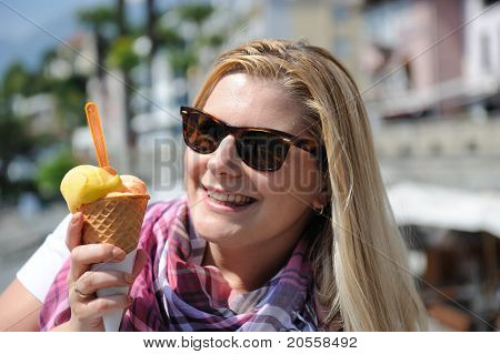 Pretty Casual Summer Girl Eating Ice Cream Outdoors