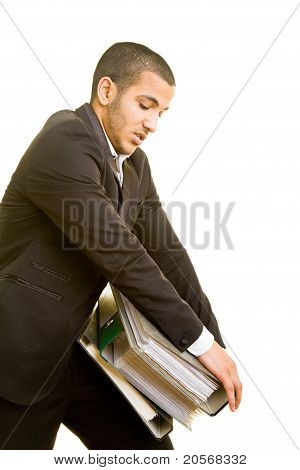 Business Man Carrying Heavy Files