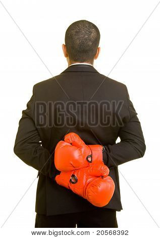 Business Man Hiding Boxing Gloves