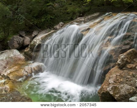 Waterfall On Mountain River