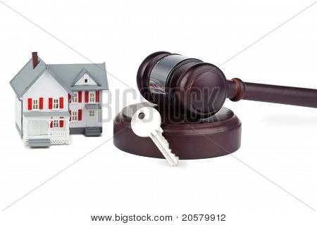 Closeup Of A Toy House Model And A Brown Gavel