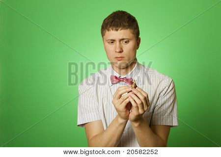 Young man holds a flower bulb