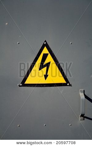 A triangular sign - a lightning symbol on a yellow background