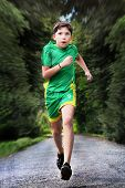 Teenager Boy In Sportswear Run On The Country Road poster